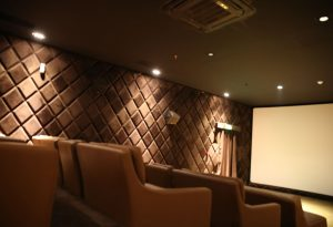 VIP cinema room with leather and comfortable armchairs